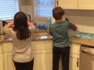 Kids caught in the act of helping.
